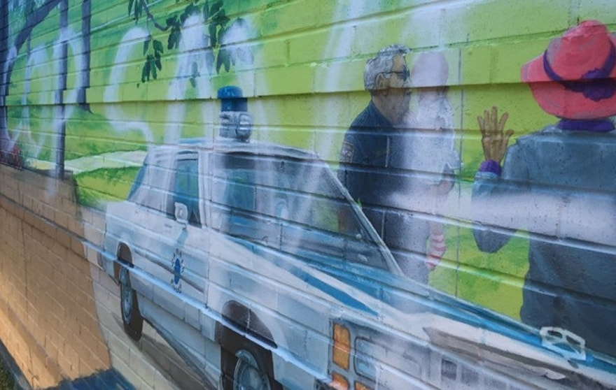 This photo shows the defaced mural on an exterior wall at the new police headquarters in Garner, N.C.