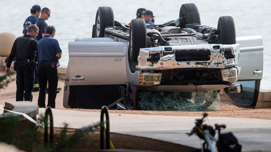 Oct. 18, 2015: Authorities investigate the scene where a vehicle went into Tempe Town Lake in Tempe, Ariz. (Patrick Breen/The Arizona Republic via AP)