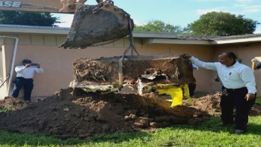 A Texas woman unearthed a coffin in her backyard containing dog bones.