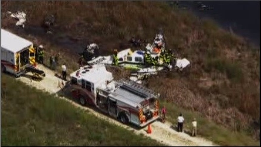 Emergency crews pull victims from the wreckage of a small plane after it crashed. (WSVN)