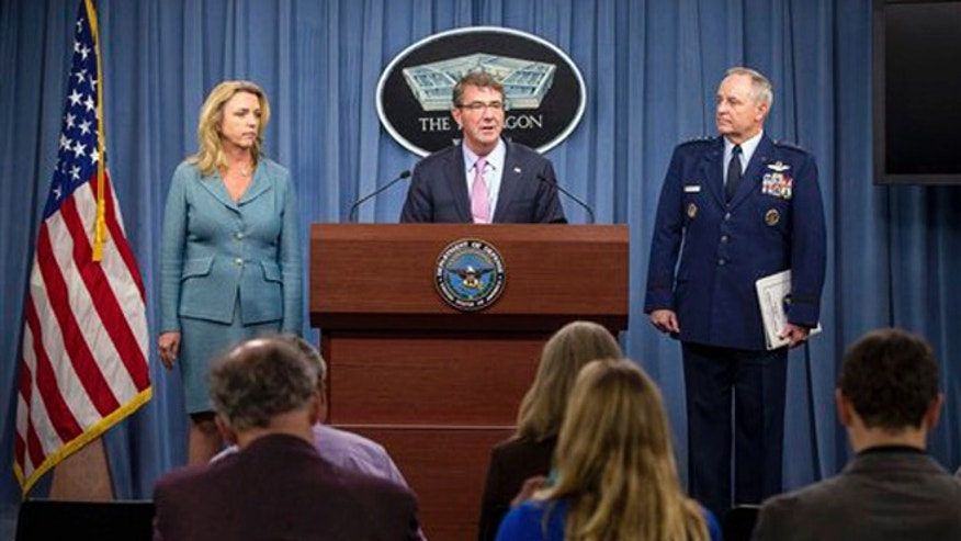 Oct. 27, 2015: Secretary of Defense Ash Carter, center, accompanied by Air Force Secretary Deborah Lee James, left, and Air Force Chief of Staff Gen. Mark Welsh III, right, speak at the announcement news conference that Northrop Grumman is being awarded the US Air Forces next-generation long range strike bomber contract at a news conference at the Pentagon.