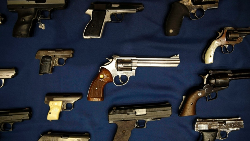 Oct. 27, 2015: Guns seized by the police are displayed during a news conference in New York,