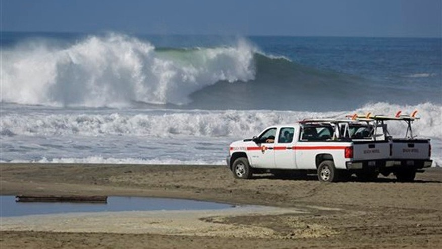 Oct. 28, 2015: The beach patrol with the National Park Service watches over the high surf at Ocean Beach in San Francisco.