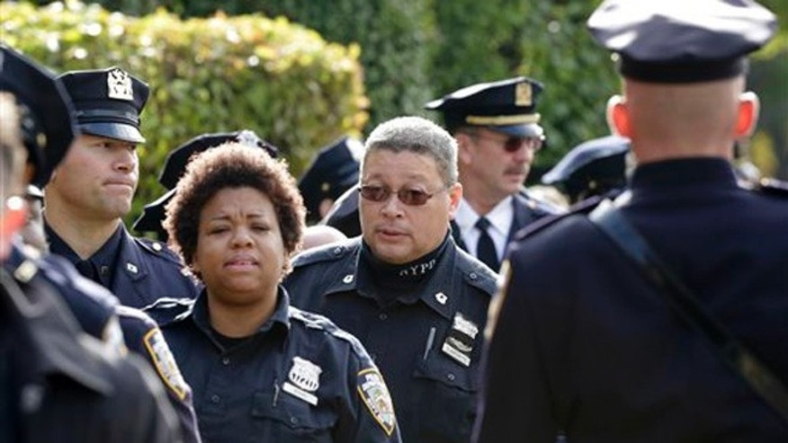 Oct. 27, 2015: New York police officers arrive for the wake of fellow officer Randolph Holder at the Greater Allen A.M.E. Cathedral in the Queens borough of New York.