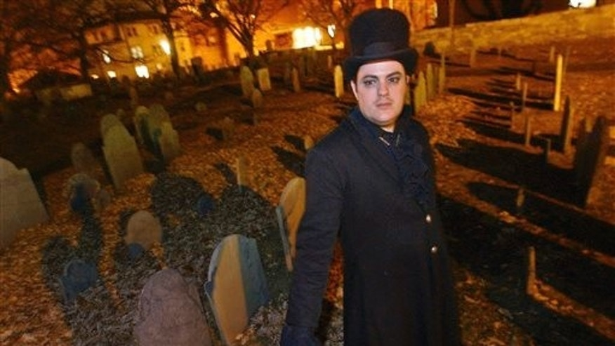 Christian Day poses in the Old Burying Ground in Salem, Mass. in 2003. (AP Photo/Lisa Poole, File)