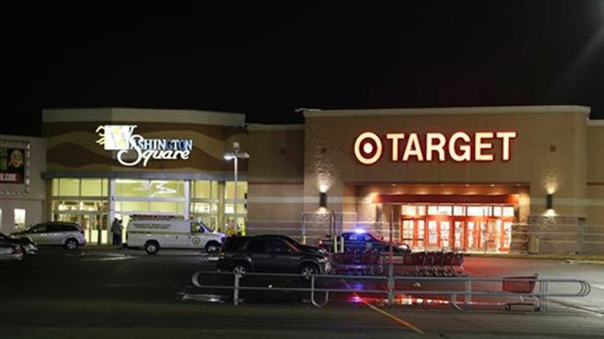 Oct. 28, 2015: Police stand outside of the entrance at the Washington Square Mall on Wednesday in Indianapolis. Indianapolis police responded to a report of multiple people shot at the shopping mall.