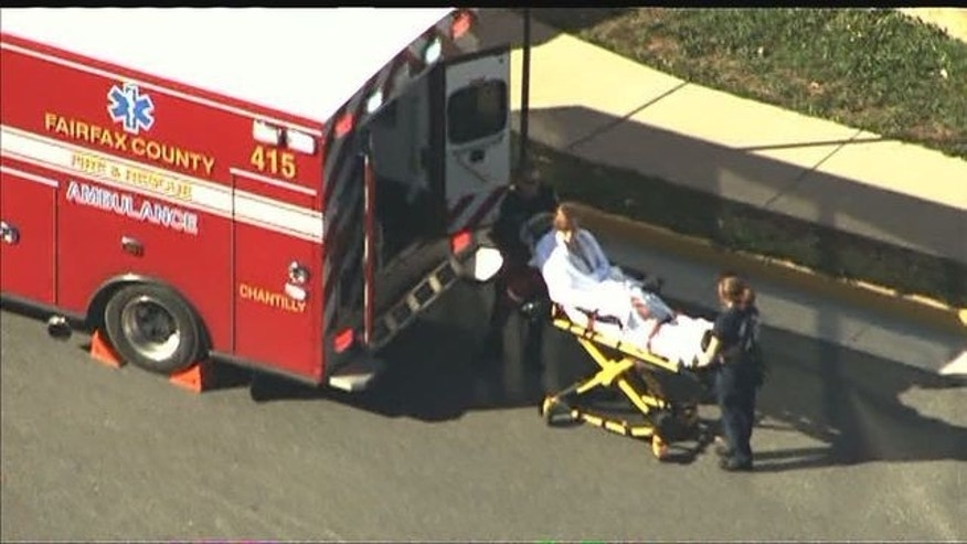 Victim transported to the hospital after a fire in a high school classroom. (Fox 5)