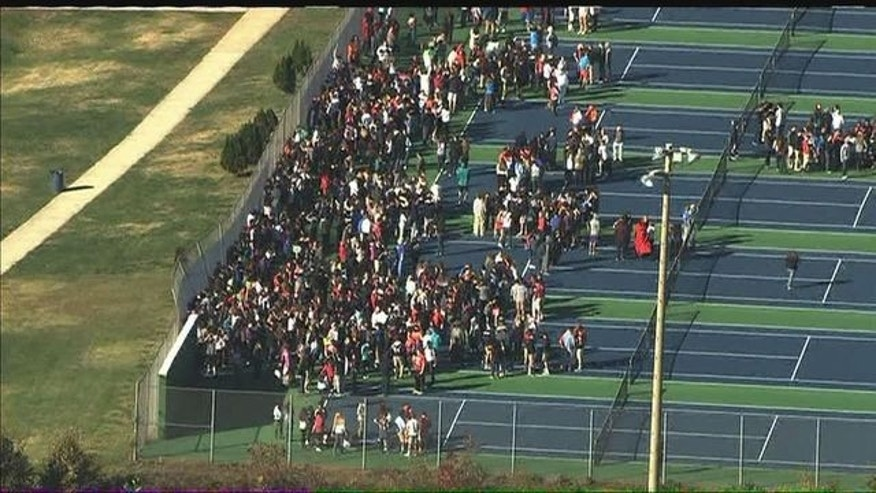 Students evacuating after a fire in a high school classroom. (Fox 5)