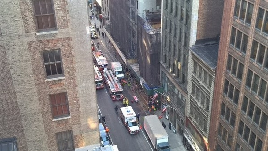 Crews at the scene of a deadly building collapse in New York City. (Ray Hennessey)