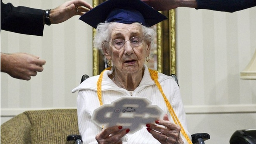 97-year-old Margaret Bekema looks at her high school letter at honorary graduation in Walker, Mich. (Emily Rose Bennett/Grand Rapids Press)