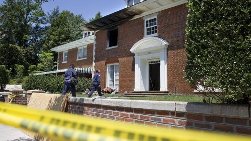 The charred Washington mansion where three family members and a housekeeper were killed.