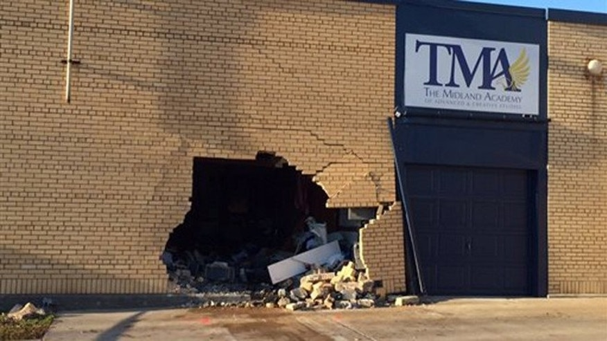 Nov. 3, 2015: This photo shows the scene where police say a vehicle crashed through the wall of Midland Academy, a school that was closed for the night, killing two passengers and injuring the driver.
