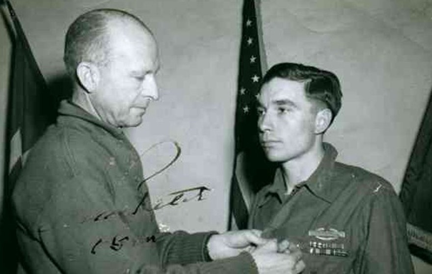 Lt. General Alexander M. Patch awards Garlin Murl Conner the Distinguished Service Cross, Feb. 10, 1945 for extraordinary heroism in action.