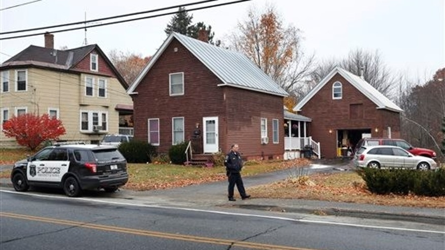 The house where two women and a man were shot to death in Oakland, Maine.