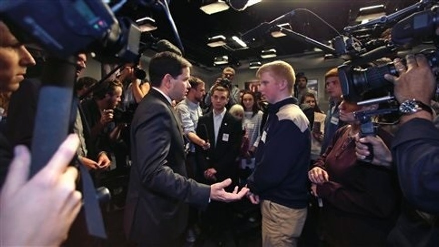 Republican presidential candidate Sen. Marco Rubio, R-Fla., talks with Jack Dwyer of Natick, Mass., right, during a campaign event at Saint Anselm College in Manchester, N.H., Wednesday, Nov. 4, 2015. (AP Photo/Charles Krupa)