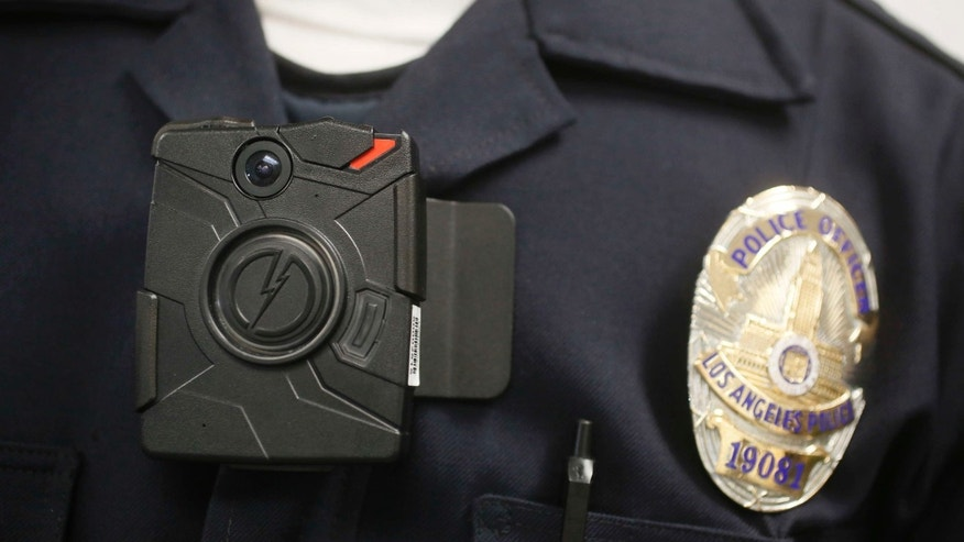 FILE - In this Jan. 15, 2014 file photo a Los Angeles Police officer wears an on-body camera during a demonstration in Los Angeles.
