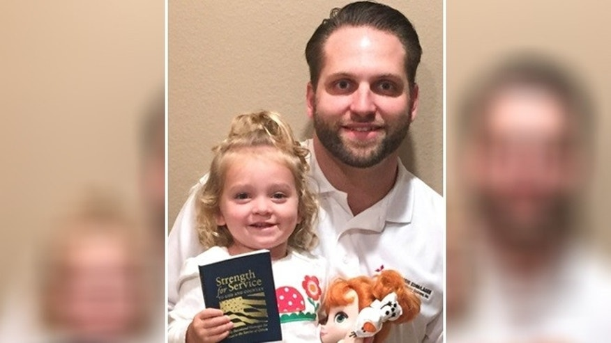 "Evan Hunsberger, 29, seen here with his daughter Caydence, has worked tirelessly since the age of 13 to reprint and distribute ""Strength or Service for God and Country."" (Courtesy of Evan Hunsberger)"