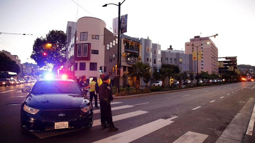 Nov. 11, 2015: Police block off Cesar Chavez near St. Luke's hospital where a shooting occurred in San Francisco.