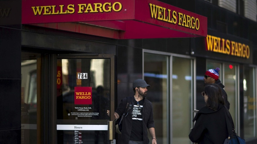 Oct. 10, 2015: People exit and enter Wells Fargo ATM in the Manhattan borough of New York.