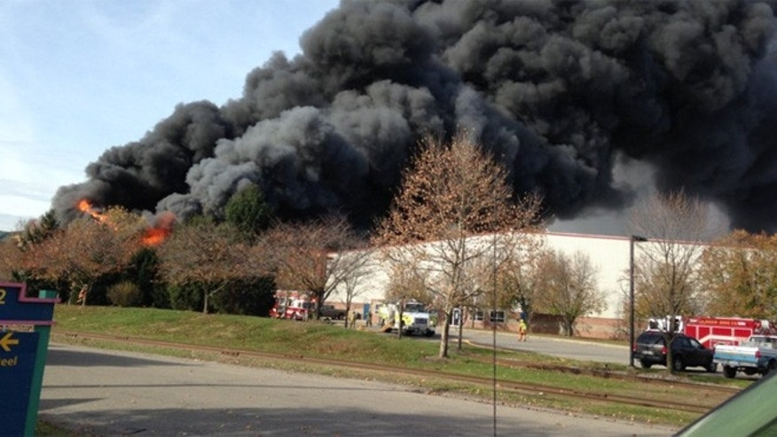 Smoke can be seen billowing from the scene of a fire in Leetsdale, Pa. The town is outside Pittsburgh.
