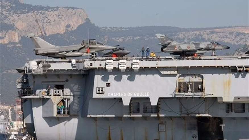 Jetfighters on the deck of France's nuclear-powered aircraft carrier Charles de Gaulle.