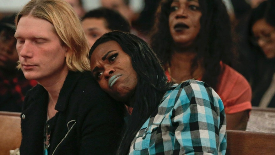 Nov. 18, 2015: a couple attending a Trans Day of Remembrance program, listen during a speech about violence against transgender people, in New York.