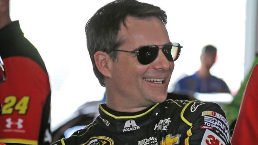 Jeff Gordon prepares to get in his car before a NASCAR Sprint Cup Series auto racing practice.