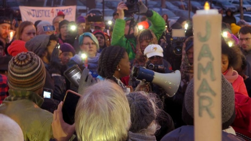 File- This Nov. 20, 2015, file photo shows Minneapolis NAACP leader Nekima Levy-Pounds speaking at a prayer vigil. Five people were shot near the site of an ongoing protest over the fatal shooting of a black man by a police officer, a Minneapolis Police Department spokesman said. (AP Photo/Greg Moore, File)