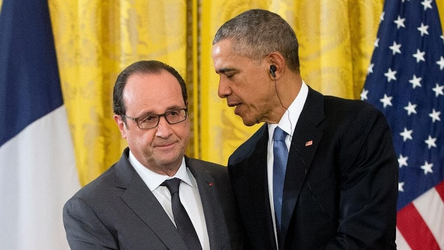 President Barack Obama shakes hands with French President Francois Hollande during their news conference in the East Room of the White House in Washington, Tuesday, Nov. 24, 2015. Hollande's visit to Washington is part of a diplomatic offensive to get the international community to bolster the campaign against the Islamic State militants. (AP Photo/Pablo Martinez Monsivais)