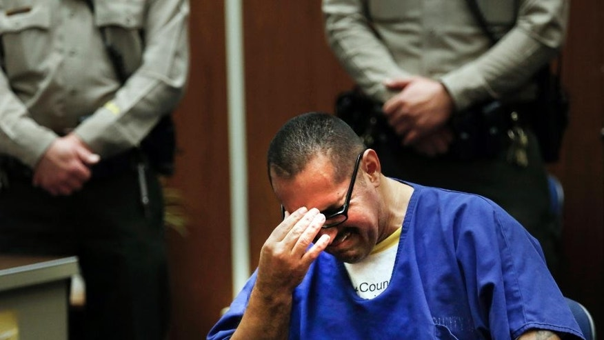 Luis Vargas, who has been in prison for 16 years, breaks down in court as he is exonerated Monday, Nov. 23, 2015, in Los Angeles. A judge exonerated Vargas, convicted of three rapes, after DNA evidence linked the crimes to a serial rapist wanted for assaults dating back two decades. (Francine Orr/Los Angeles Times via AP, Pool)