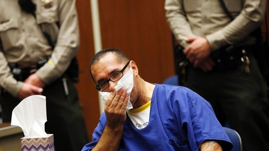 Luis Vargas, who has been in prison for 16 years, reacts in court as he is exonerated Monday, Nov. 23, 2015, in Los Angeles. A judge exonerated Vargas, convicted of three rapes, after DNA evidence linked the crimes to a serial rapist wanted for assaults dating back two decades. (Francine Orr/Los Angeles Times via AP, Pool)
