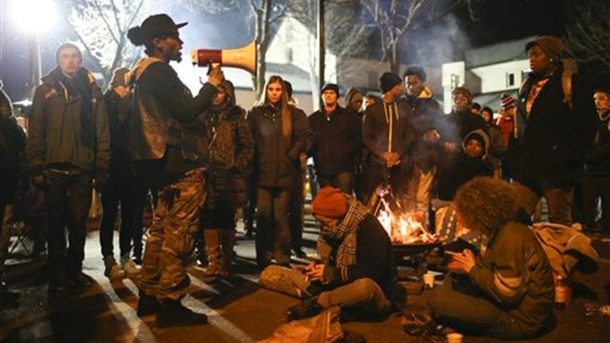 Nov. 24, 2015: A demonstrator speaks about his encounter with attackers who were shooting at five protesters near the Minneapolis Police 4th Precinct earlier in the night, as protesters gather in front of the precinct in Minneapolis.