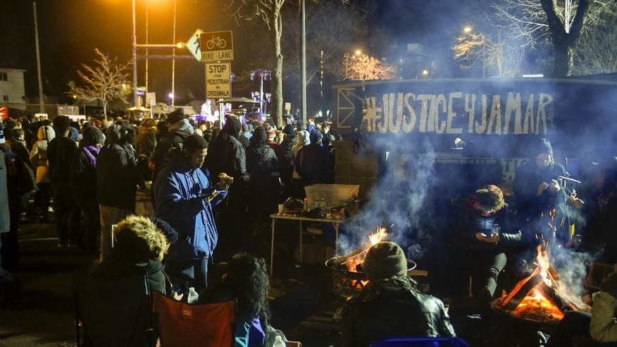 Demonstrators camp outside the Minneapolis Police Department's 4th Precinct during a protest for the death of Jamar Clark, Tuesday, Nov. 24, 2015, in Minneapolis. The fatal shooting of  Clark, a black man, by a Minneapolis police officer, has pushed racial tensions in the city's small but concentrated minority community to the forefront, with the police precinct besieged by the makeshift encampment and many protesters. (AP Photo/Craig Lassig)