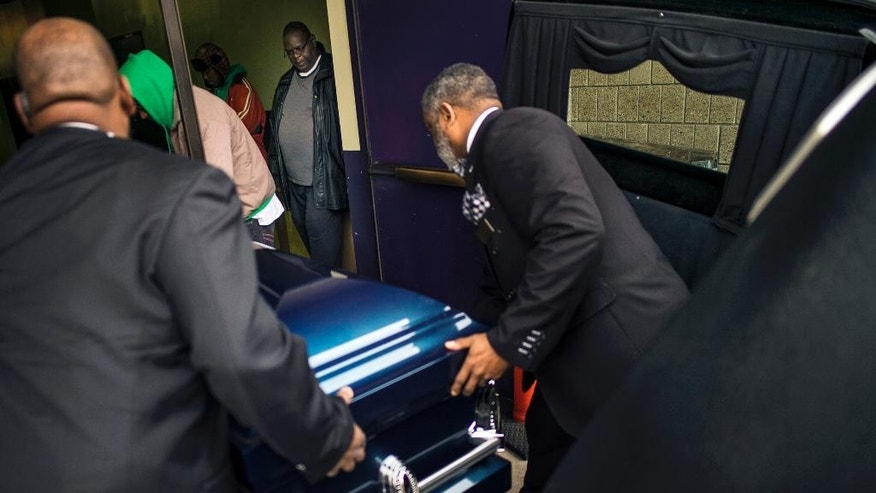 People carry the casket of Jamar Clark, killed in the Nov. 15 shooting by Minneapolis police, during his funeral at Shiloh Temple International Ministries in Minneapolis, Minn., Wednesday, Nov. 25, 2015. Some community leaders called for peace on the day of the funeral, as family members also asked for no protests. (Richard Tsong-Taatarii/Star Tribune via AP)