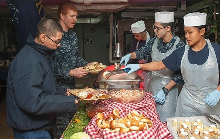 Volunteers from various departments aboard the Nimitz-class aircraft carrier USS George Washington (CVN 73) serve food to Sailors during a Thanksgiving lunch hosted by the ship. (U.S. Navy photo)