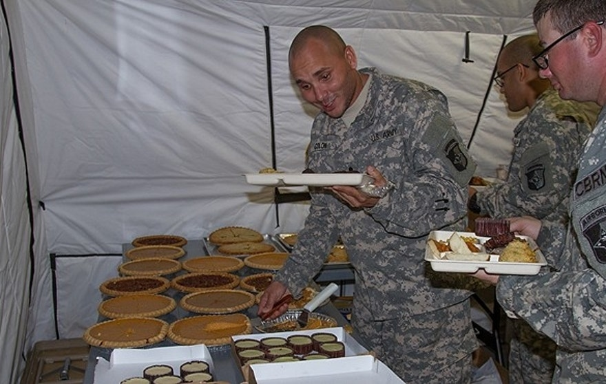 Nov. 27, 2014: Soldiers with Task Force Lifeliner, Joint Forces Command and United Assistance dive into one of the many pies and desserts offered in the dining facility at brigade support area in Buchanan, Liberia. (U.S. Army photo)
