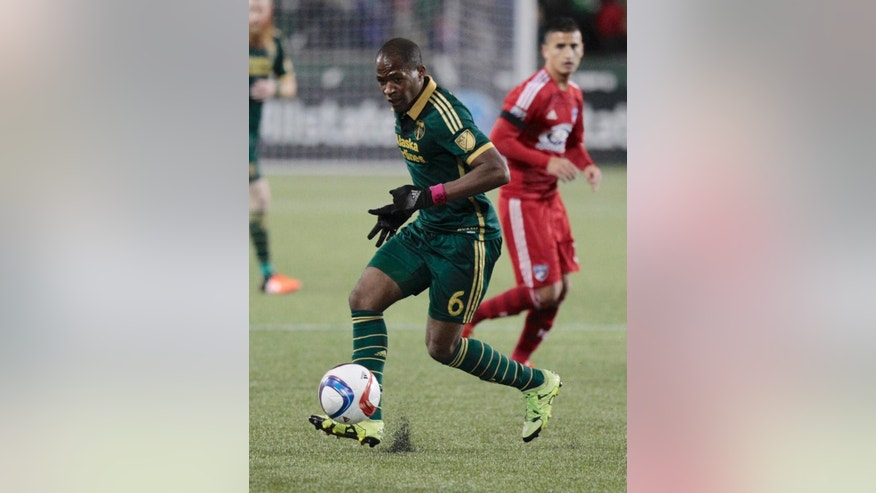 In this Nov. 22, 2015, photo, Portland Timbers forward/midfielder Darlington Nagbe (6) moves the ball against FC Dallas during the first half of the first leg of the MLS soccer Western Conference championship in Portland, Ore. Things couldn't be better for Darlington Nagbe. The 25-year-old became a U.S. citizen in September, he's just returned from his first call-up with the U.S. national team, and his Portland Timbers are rolling in the MLS Cup playoffs. To top it off, Nagbe and his wife are expecting a son next month. (AP Photo/Steve Dipaola)