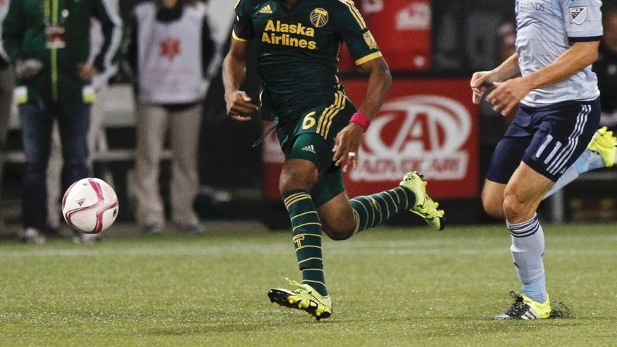 In this Oct. 3, 2015, photo, Portland Timbers forward/midfielder Darlington Nagbe (6) moves the ball against Sporting KC midfielder Bernardo Anor (11) during the first half of an MLS soccer match in Portland, Ore. Things couldn't be better for Darlington Nagbe. The 25-year-old became a U.S. citizen in September, he's just returned from his first call-up with the U.S. national team, and his Portland Timbers are rolling in the MLS Cup playoffs. To top it off, Nagbe and his wife are expecting a son next month. (AP Photo/Steve Dipaola)