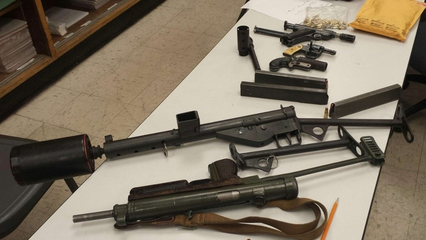 This Nov. 2015 photo released by the Los Angeles County Sheriff's Department, shows five firearms, including two operable World War II-era machine guns, confiscated after an arrest was made as deputies were on foot patrol at a homeless encampment near Harbor City, Calif.