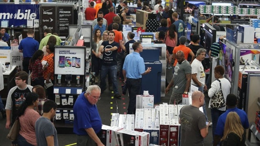 Nov. 26, 2015: People look at merchandise while holiday shopping at Best Buy in Panama City, Fla. (Patti Blake/News Herald via AP)
