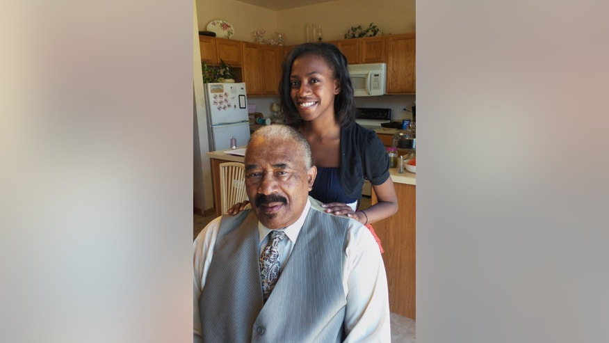 Vanyce Grant poses with her grandfather Bernie Stuart at her home in Bolingbrook, Ill., on Thursday, Nov. 19, 2015. Grant interviewed Stuart for StoryCorps' Great Thanksgiving Listen oral history project. High school students across the country are making history this weekend by recording interviews with their elders in an unprecedented effort to stockpile wisdom for the ages.  (AP Photo/Sophia Tareen)