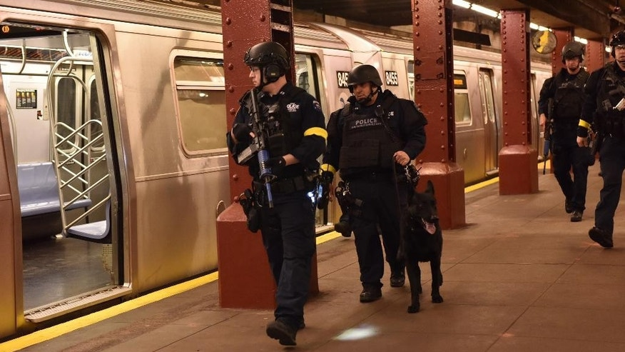 "FILE - In this Sunday Nov. 22, 2015, file photo, provided by the New York Police Department, police stage a drill simulating an attack in an abandoned subway station in New York. Since the Paris attacks, U.S. police officials and security experts have been hammering home the hard realities of so-called ""active shooter"" incidents. Officials believe the best chance to preserve life is for ordinary police officers not to hesitate to charge in and kill the attackers. (New York Police Department via AP, File)"