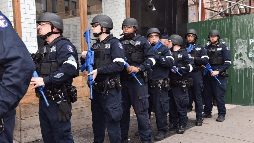 "FILE - In this Sunday, Nov. 22, 2015, file photo, provided by the New York Police Department, NYPD officers line up near an abandoned subway station to stage a drill simulating an attack, in New York. Since the Paris attacks, U.S. police officials and security experts have been hammering home the hard realities of so-called ""active shooter"" incidents. Officials believe the best chance to preserve life is for ordinary police officers not to hesitate to charge in and kill the attackers. (New York Police Department via AP, File)"