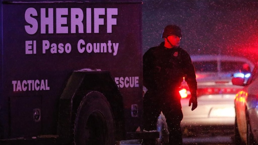 Police stand guard after a suspect was apprehended Friday, Nov. 27, 2015, in northwest Colorado Springs, Colo. A gunman opened fire at a Planned Parenthood clinic on Friday, authorities said, wounding multiple people. (AP Photo/David Zalubowski)