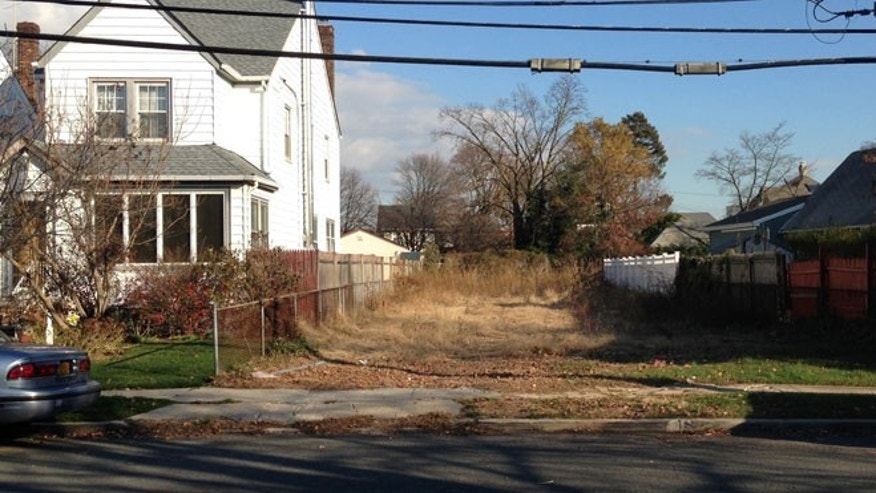 A lot stands empty in West Hempstead, N.Y., after the township had the home that once stood on it torn down.