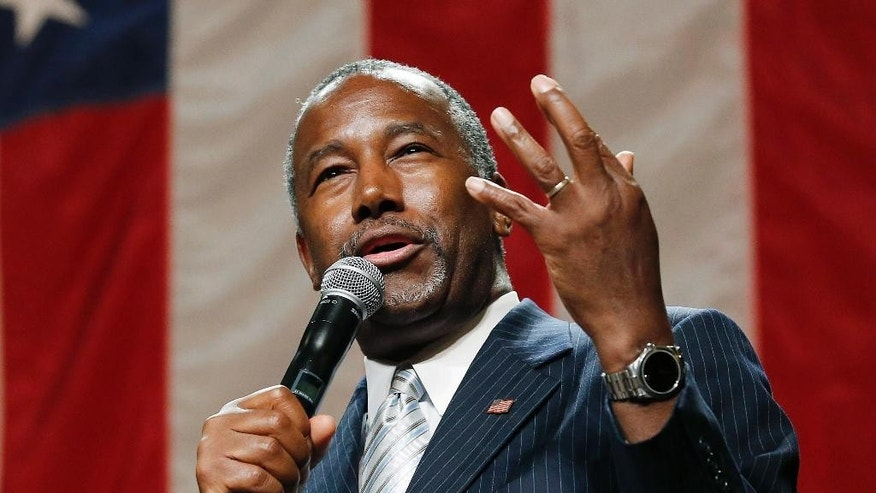 "FILE - In this Aug. 18, 2015 file photo, Republican presidential candidate Ben Carson delivers a speech to supporters in Phoenix. Some leading Republican presidential candidates seem to view Muslims as fair game for increasingly harsh words they might not dare use against any other group for fear of the political cost. So far, that strategy is winning support from conservatives influential in picking the nominee. Carson said allowing Syrian refugees into the U.S. would be akin to exposing a neighborhood to a ""rabid dog.""  (AP Photo/Ross D. Franklin, File)"