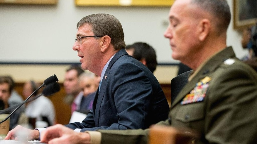 Defense Secretary Ash Carter, left, accompanied by Joint Chiefs Chairman Gen. Joseph Dunford Jr., testifies on Capitol Hill in Washington, Tuesday, Dec. 1, 2015, before the House Armed Services Committee hearing on the U.S. Strategy for Syria and Iraq and its Implications for the Region.  (AP Photo/Andrew Harnik)