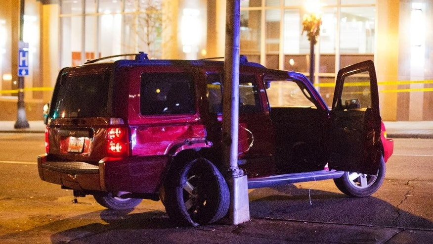 A vehicle is shown at the scene of an officer-involved shooting, Tuesday, Dec. 1, 2015, in downtown Atlanta, that left one person dead after an officer attempted to stop the vehicle on Monday. (AP Photo/David Goldman)