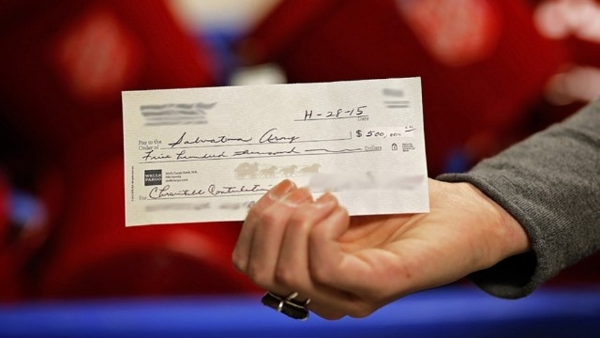 Nov. 30, 2015: This photo provided by the Twin Cities Salvation Army shows a check for $500,000 that was skipped into one of the charity's signature red baskets. The identifies of the donors have been obscured because they wish to remain anonymous. (The Salvation Army)