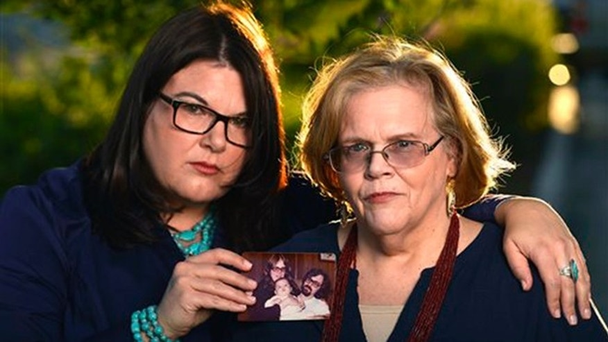 "This June 18, 2015 photo shows Jennifer ""Jenn"" Carson, left, 40, and Lynne Carson Gonzales, 66, daughter and former wife of serial killer Michael Bear Carson, in Moreno Valley, Calif. Both are fighting the release of Carson and his current wife Suzan Carson the so-called San Francisco Witch Killers who are now eligible for parole.  (AP Photo/Rodrigo Pena))"